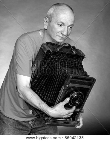 Man With Vintage Wooden Photo Camera