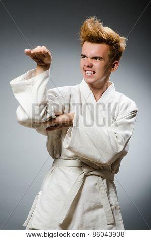 Funny karate fighter wearing white kimono