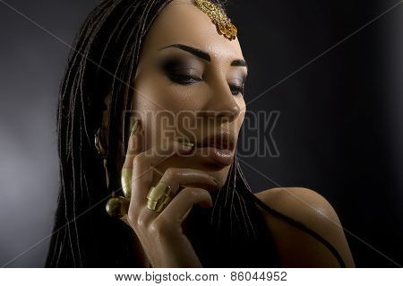 Fashion Beauty And Stylish Hair. Make-up. Beautiful Sexy Woman With Luxury Glossy Gold Makeup. Beaut