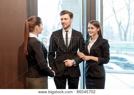 Businesswoman sees off business couple