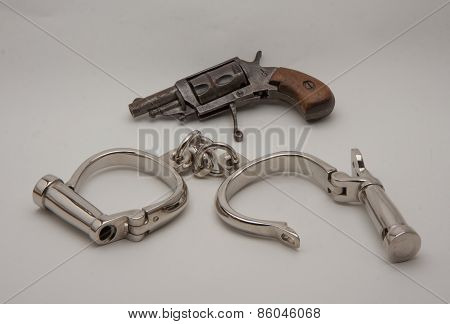 Old Handcuffs And Revolver