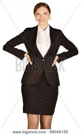 Young office worker smiling putting hands on lower back