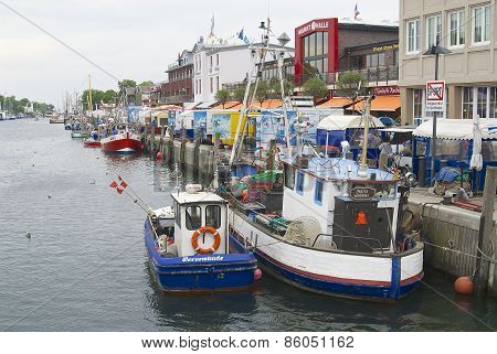 Fishing boats tied at the channel in Rostock, Germany.