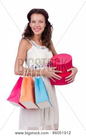 A girl does shopping isolated on white