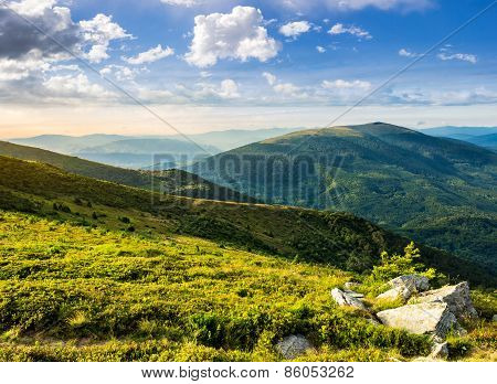 Hillside With Stones In High Mountains At Sunrise