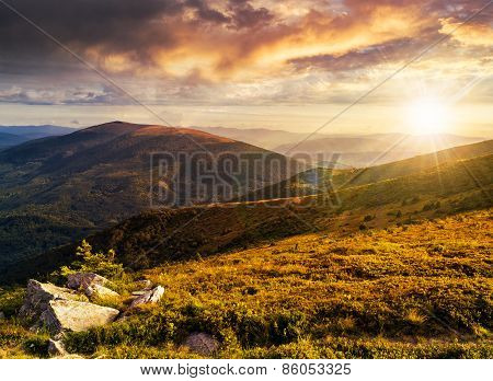 Hillside With Stones In High Mountains At Sunset