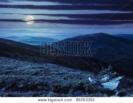 Hillside With Stones In High Mountains At Night