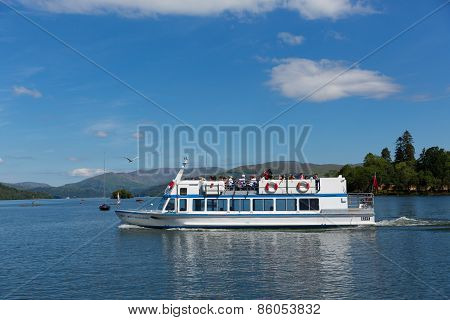 Bowness on Windermere Lake District England UK visitors enjoying tourist attractions like boat trips