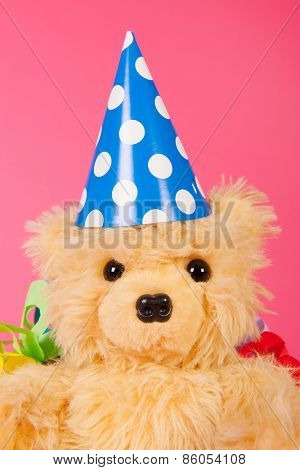 Portrait of birthday bear om pink