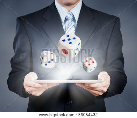 Businessman Using Tablet Showing Dice, Risk Management Concept