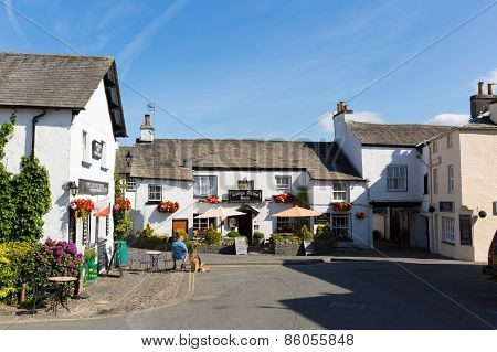 Hawkshead Lake District village square with pub and shop Cumbria England uk
