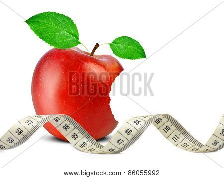 bitten red apple with measuring tape