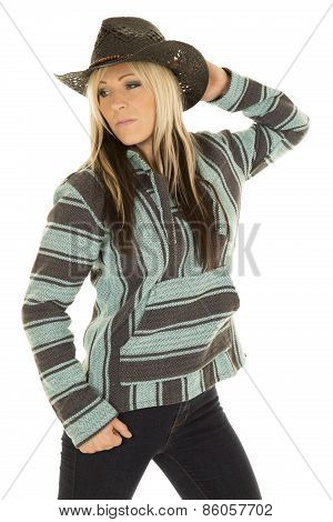 Cowgirl In Blue And Black Poncho Hand On Hat Look Side