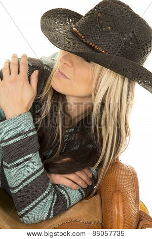 Cowgirl In Blue And Black Poncho Lean On Saddle Look Up To Side