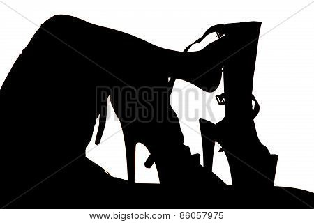 Silhouette Of  Womans Legs And Feet By Really High Heels