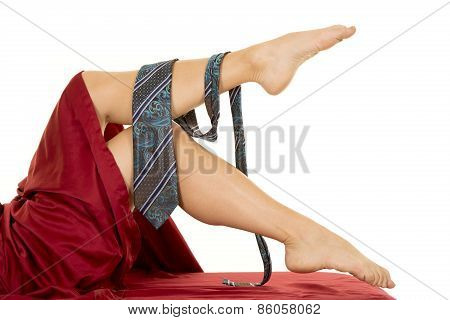 Woman Laying Legs Out Of Sheet With Mans Tie