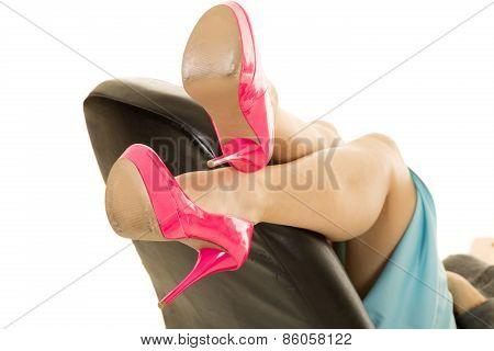 Woman Legs In Pink Heels Lay On Office Chair In Skirt