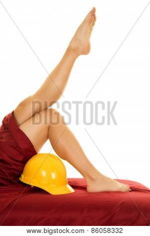 Woman Legs With Red Sheet Leg Up Over Construction Hat