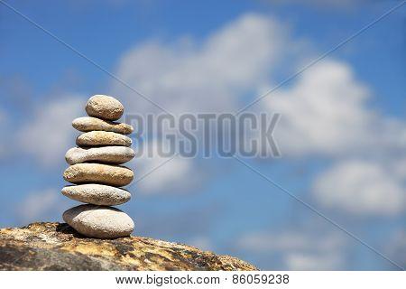 Stone Tower On A Pebble Beach Again Blue Sky