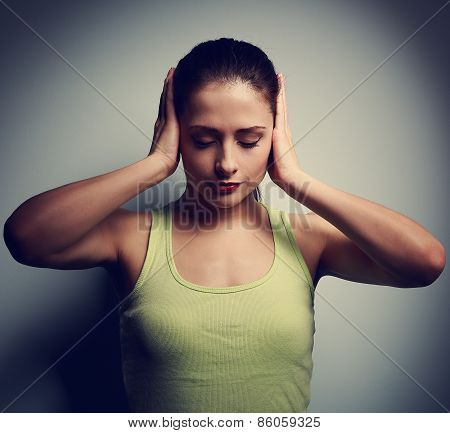 Confusion Unhappy Thinking Woman With Headache On Dark Background
