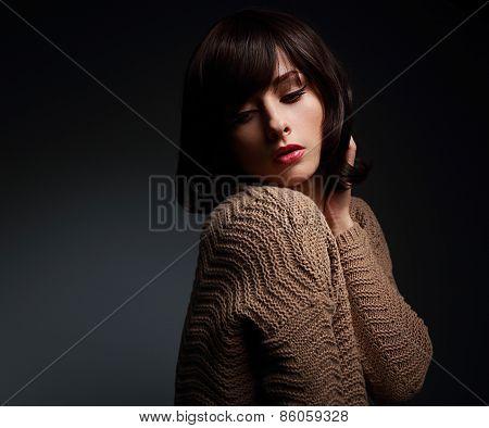 Sexy Makeup Female Model Posing In Warm Wool Sweater