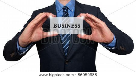 Businessman holds white card with Business sign. Isolated on various backgrounds ( grey, blue, offic