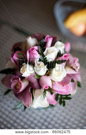 Pink wedding bouquet with roses and orchids