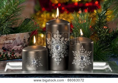 Closeup Of Colored Christmas Candles On Colored Background