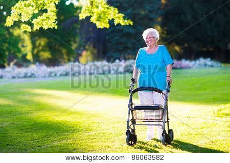 Senior Handicapped Lady With A Walker In A Park