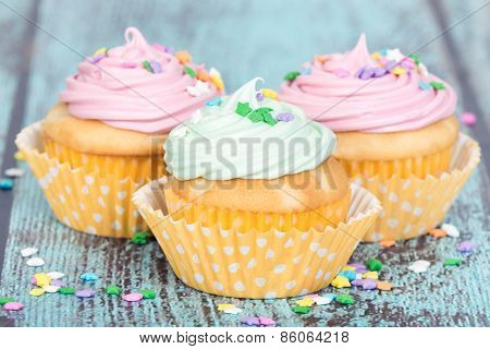 Pastel Cupcakes With Sprinkles On Blue Vintage Background