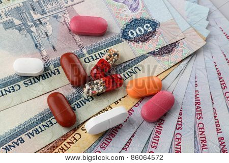United Arab Emirates Currency Dirhams And Medicine Pills