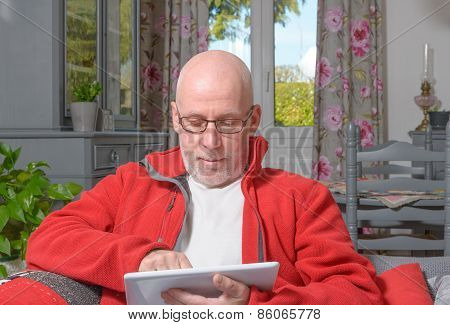 A Senior Man With A Digital Tablet