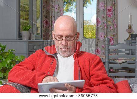 A Senior Man With A Digital Tablet