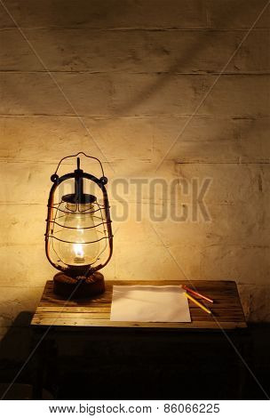 Kerosene Lantern On Wooden Table