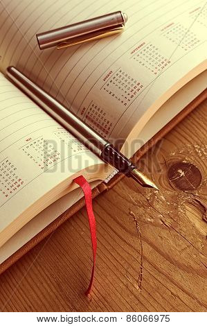 Open Diary With One Fountain Pen In It