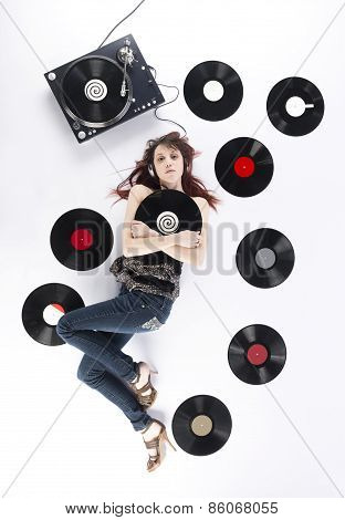 Woman Lying on Floor with Turntable and Records