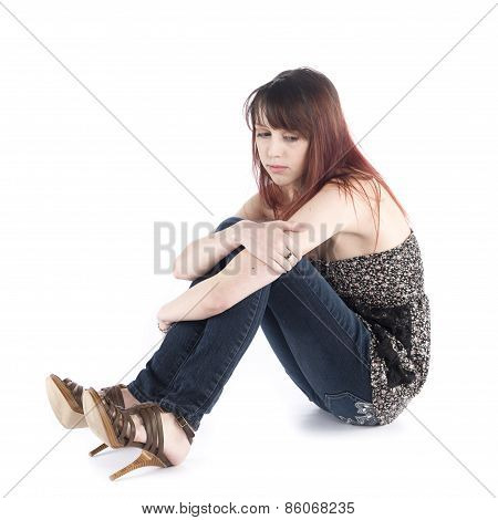 Sad Woman Sitting on the Floor Embracing her Knee