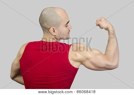 Bodybuilder Showing His Biceps Muscles.