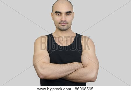Portrait Of A Muscular Man. Handsome Bald Man With Arms Crossed.