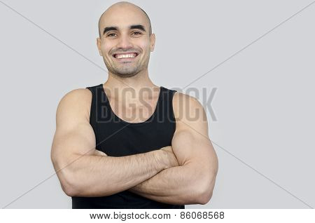 Portrait Of A Muscular Man Smiling. Handsome Bald Man With Arms Crossed.