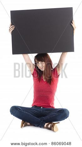 Sitting Young Woman Raising Empty Black Cardboard