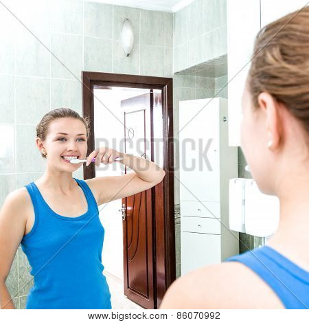 Young Smiling Woman Cleaning Teeth
