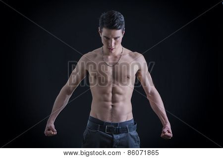 Topless Muscular Man Clenching Fists Down On Sides