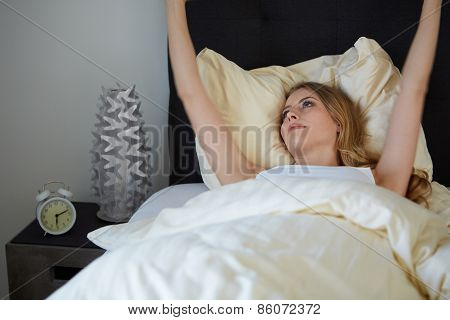attractive woman stretching in the morning