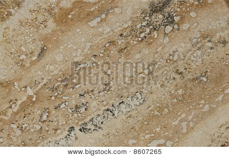 Surface Of The Travertine. Tints Of Brown And Beige. Mottled Pattern.