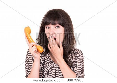 beautiful young woman using retro orange telephone