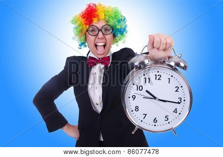 Funny clown with clock on white