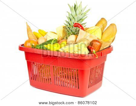 Many fuits and vegetables and other food in red shopping basket