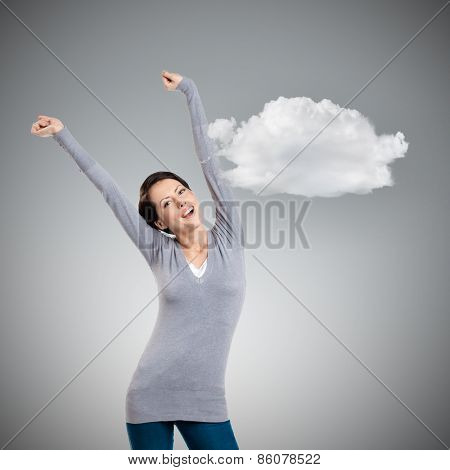 Pretty young girl puts her hands up, grey background