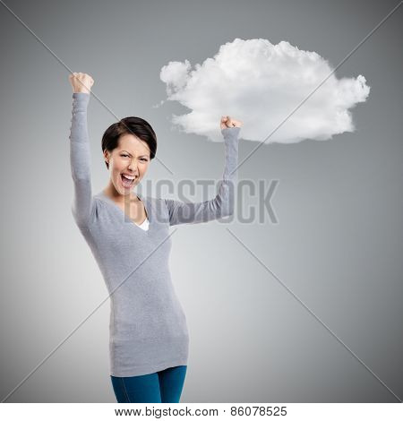 Beautiful girl yes gesturing is happy, isolated on grey background with cloud